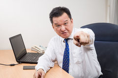Angry and stressful Asian manager shouting and pointing in offic Royalty Free Stock Photography