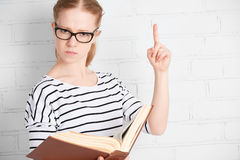 Angry strict serious teacher student with book Stock Photography