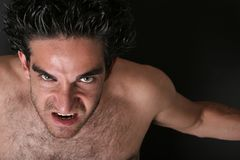 Angry strong man Stock Images