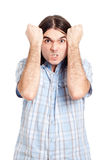 Angry stubborn man. Young angry stubborn man gesturing, isolated on white background Stock Images
