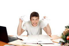 Angry Student. With rumpled papers in his hands. Isolated on the white background Royalty Free Stock Photo