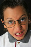 Angry student boy. With glasses Royalty Free Stock Photo