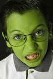 Angry student boy. Angry green student boy with glasses Royalty Free Stock Image