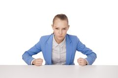 Angry Student with fists on table. Royalty Free Stock Photography