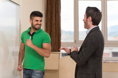 Angry Student Threatens Teacher At The Classroom. Young Arabic Student Threatens Teacher At The Classroom In Front Of The Whiteboard Stock Images
