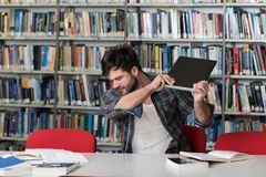 Angry Student Wants To Break His Laptop. Handsome Male Student Throwing Laptop And Want To Destroy It Stock Images