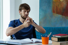 Angry student during work Royalty Free Stock Images