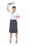 Angry stylish businesswoman throwing newspaper away Royalty Free Stock Images
