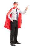 Angry superhero gesturing with his finger Royalty Free Stock Photos