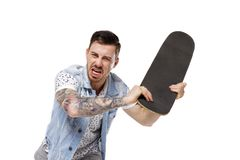 An angry tattooed man attacks. Stock Images