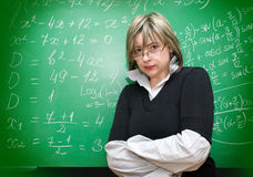 Angry teacher. With blackboard on the background royalty free stock photos