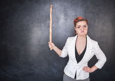 Angry teacher with pointer royalty free stock photo