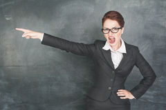 Angry teacher pointing out royalty free stock images