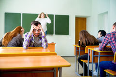 Angry teacher yelling. Angry female teacher is yelling at students stock photos