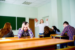 Angry teacher yelling. Angry female teacher is yelling at students stock image