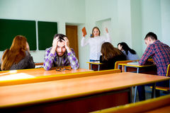 Angry teacher yelling. Angry female teacher is yelling at students royalty free stock photos