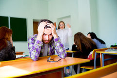 Angry teacher yelling. Angry female teacher is yelling at students royalty free stock images