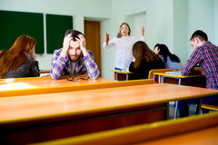 Angry teacher yelling. Angry female teacher is yelling at students stock photography