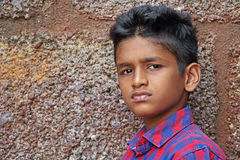 Angry Teen Boy. Teenage boy in angry and upset mood, red brick wall background royalty free stock photos