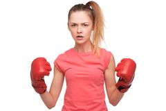 Angry teen girl with boxing gloves Stock Photos