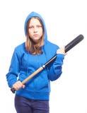 Angry teen girl in hood with baseball-bat. Studio shot Stock Image