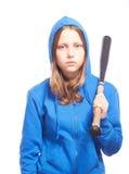 Angry teen girl in hood with baseball-bat. Studio shot Royalty Free Stock Photo