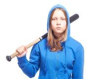 Angry teen girl in hood with baseball-bat. Studio shot Royalty Free Stock Photos