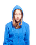 Angry teen girl in poor. Angry teen girl in hood, studio shot Royalty Free Stock Photos
