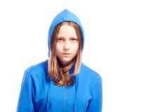 Angry teen girl in poor. Angry teen girl in hood, studio shot Stock Photo