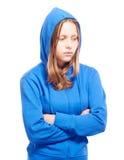Angry teen girl in poor. Angry teen girl in hood, studio shot Stock Photography