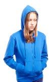 Angry teen girl in poor. Angry teen girl in hood, studio shot Stock Photos