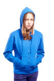 Angry teen girl in poor. Angry teen girl in hood, studio shot Royalty Free Stock Image