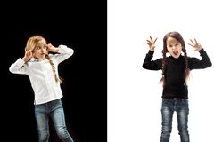 Angry teen girls standing on studio background. royalty free stock photo