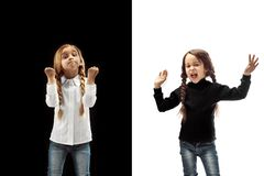 Angry teen girls standing on studio background. royalty free stock photography
