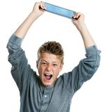 Angry teen raising tablet. Stock Photography