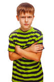 Angry teenage boy child feels anger blonde in a Royalty Free Stock Images