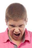 Angry teenage boy screaming Stock Photography