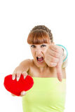 Angry teenage woman being hurt and heart broken suffers. Love hurts , Miserable girl squeezing heart stock images
