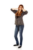 Angry teenage woman covering ears with hands.  Royalty Free Stock Photos