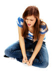 Angry teenage woman sitting on the floor and screaming Royalty Free Stock Photo