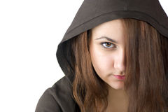 Angry Teenager. With brown eyes wearing hood hiding face behing hair Royalty Free Stock Photos