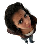 Angry teenager. A teenage angry indian girl. The picture was taken with fisheye lens Royalty Free Stock Photos