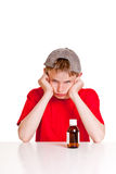 Angry teenager behind medicine bottle Stock Images
