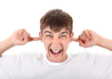 Angry Teenager with Closed Ears Stock Image