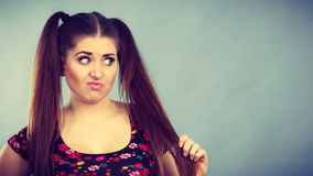 Angry teenager girl with brown hair ponytails Royalty Free Stock Photos
