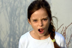 Angry teenager girl. With freckles, shouting royalty free stock photos
