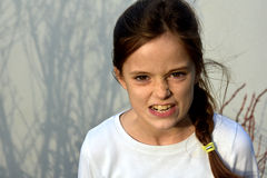 Angry teenager girl. With freckles, shouting royalty free stock photography