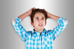 Angry teenager. On grey background Royalty Free Stock Photos
