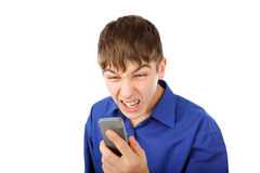 Angry teenager with phone Royalty Free Stock Photography