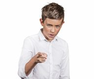 Angry teenager, pointing finger at someone, displeased, blaming. Portrait angry teenager, pointing finger at someone, displeased, blaming isolated white Stock Photo